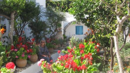 Dina Titus in a Greek garden while visiting relatives in Trikala