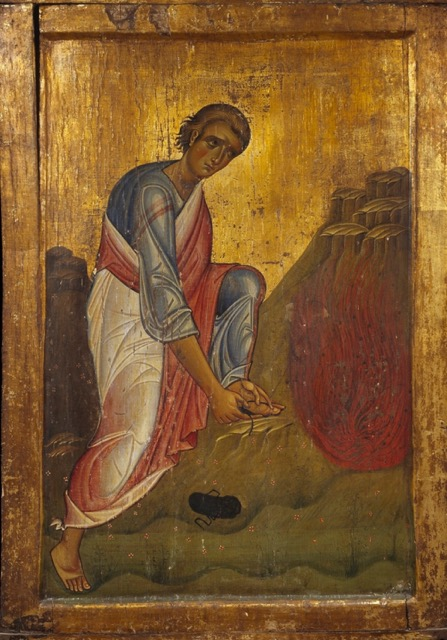 Moses removing his sandals