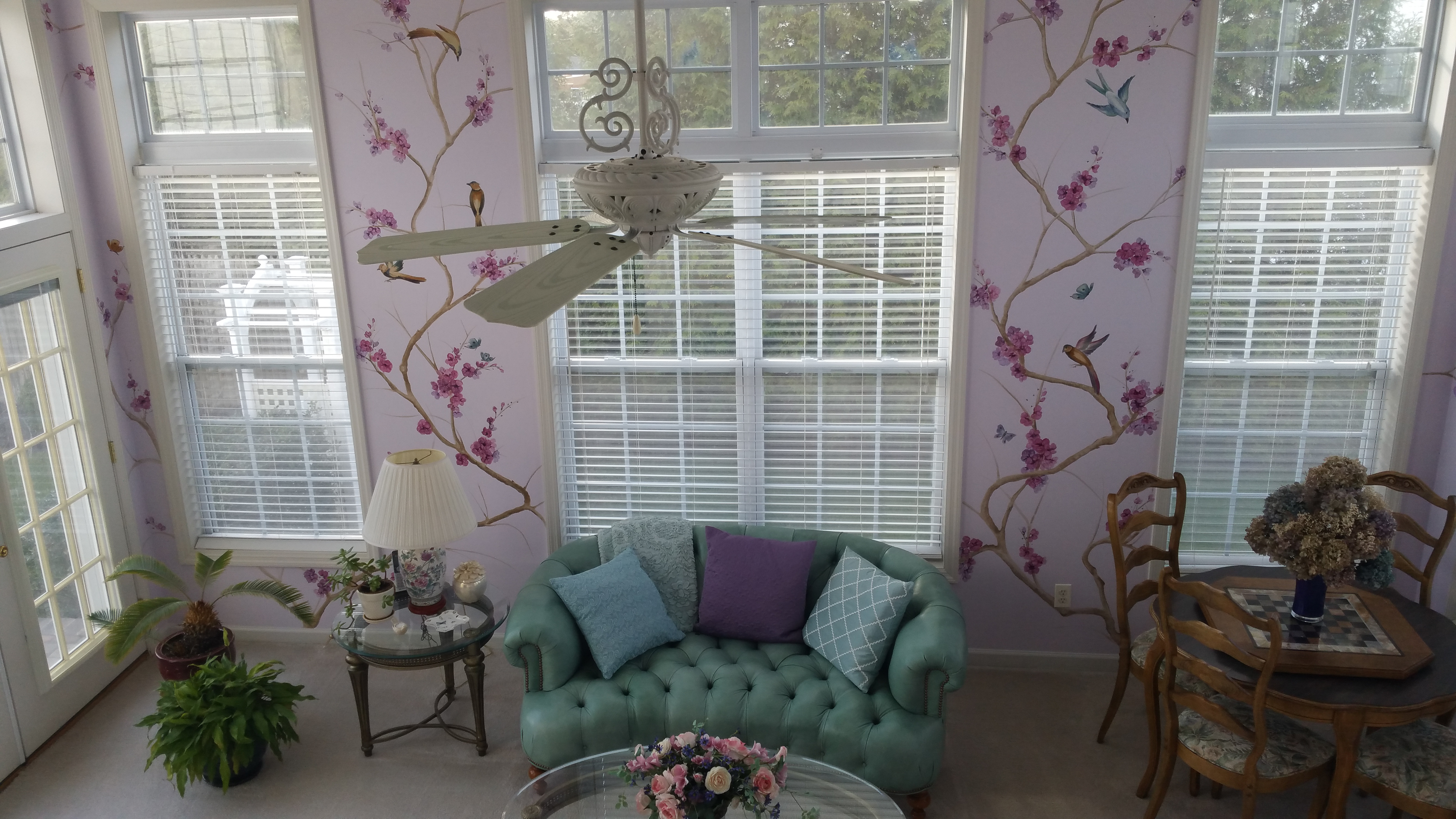 A mundane sitting room is transformed into an Asian-cherry blossom inspired lavender dreamscape, perfect for taking in a cup of tea in the sunshine.