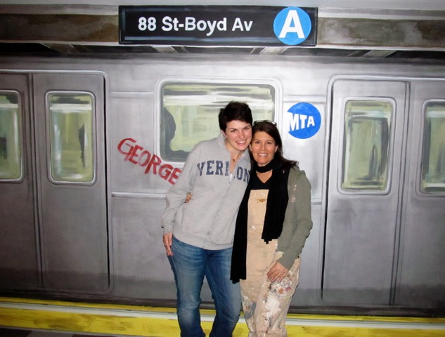 In front of a subway mural, Kathy Burbaris with her niece and part-time assistant Danielle Bubaris Maxwell