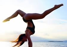"""Only when you can turn your world upside down by performing a handstand,  can you do things that you thought were impossible to do"" Irene Damanaki, yoga practitioner and trainer"