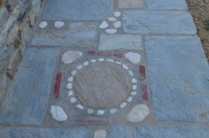 Natural marble stones found at the beach create a rugged walkway mosaic