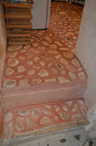 natural stone creates the mosaic-like tiles of a village kitchen