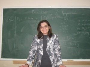 The ambassador of Greek letters and culture in front of her blackboard at Birzeit University