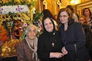 Evangelia with mom, far left, and nun during the recent Orthodox holiday of the Koimisis tis Theotokou