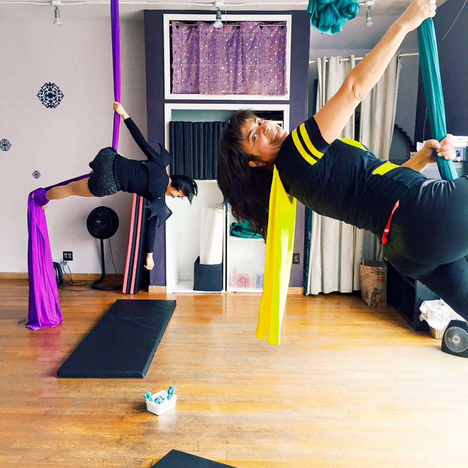 Esther Negrin torques around fabric in a Cirque du Soleil style gym routine at one of the four gyms she attends regularly.