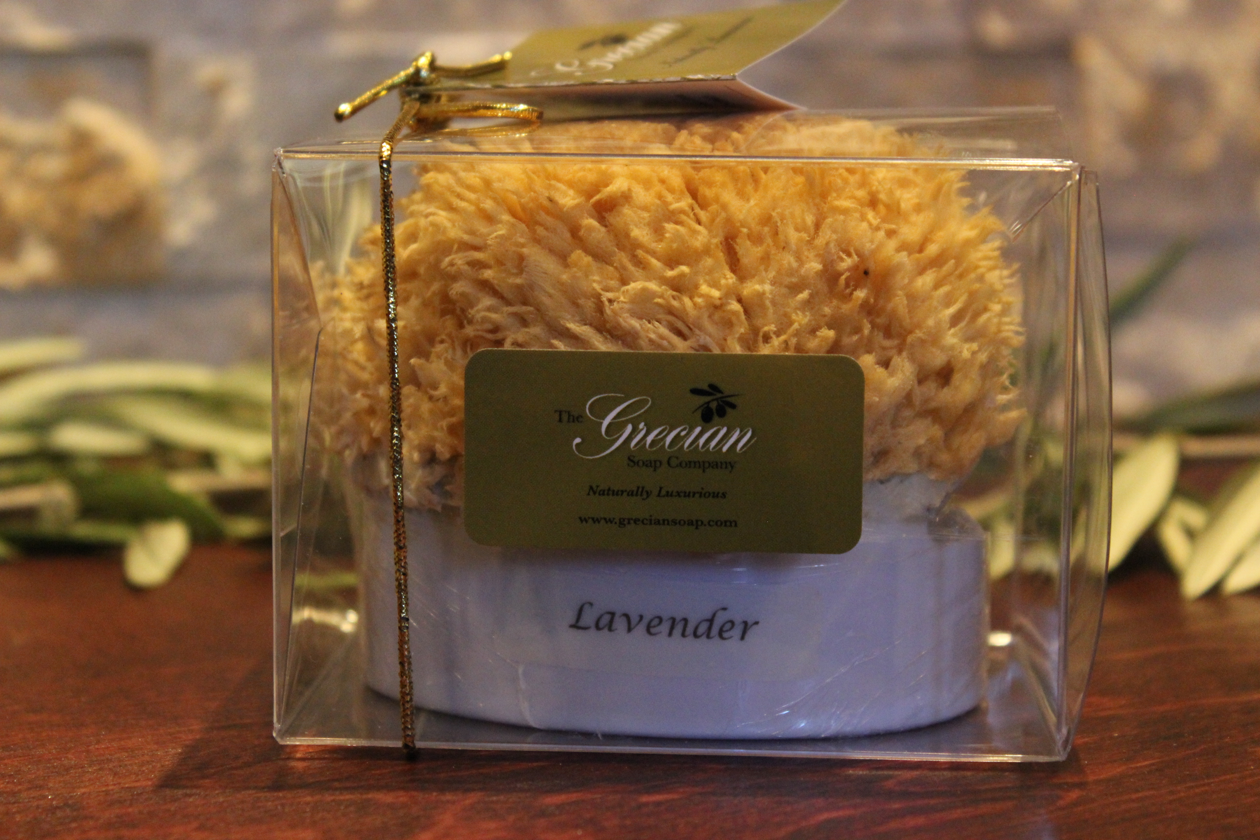 Lavender scented goat's milk soap embedded in a natural sea sponge by Grecian Soap Company