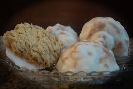 Conch-shell shaped goat's milk soap embedded in natural sea sponge--what a remarkable idea!
